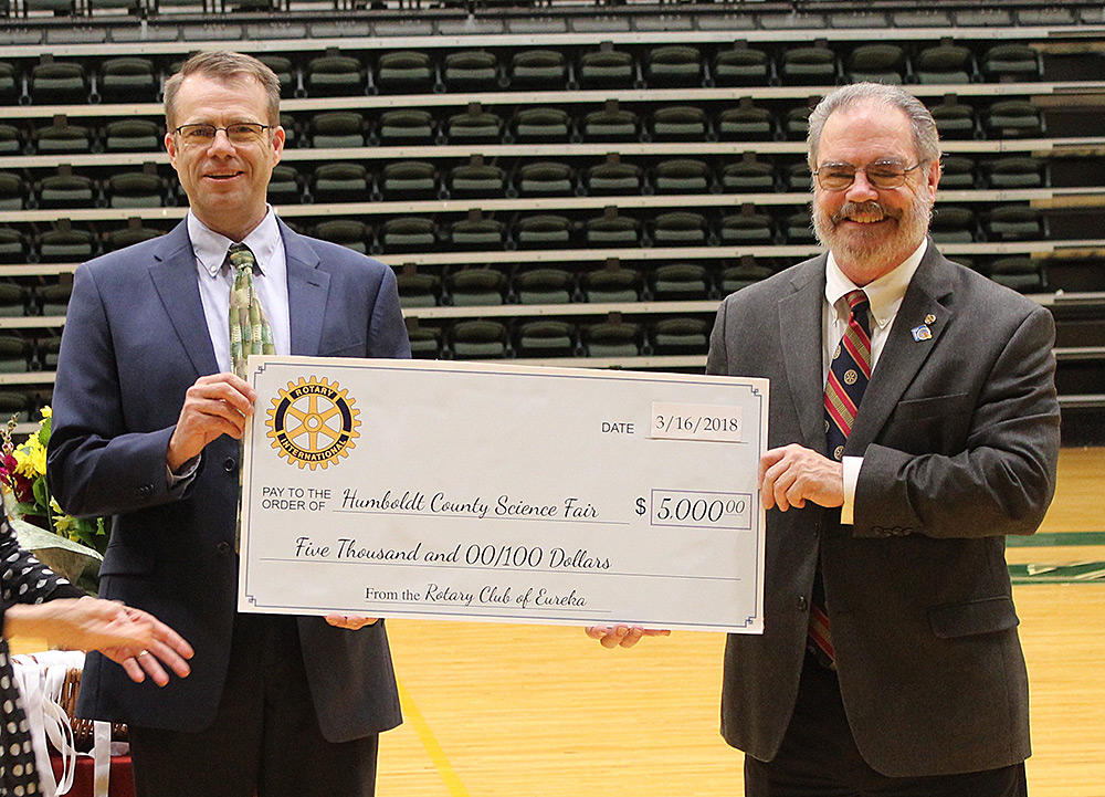Superintendent Chris Hartley with rotary check